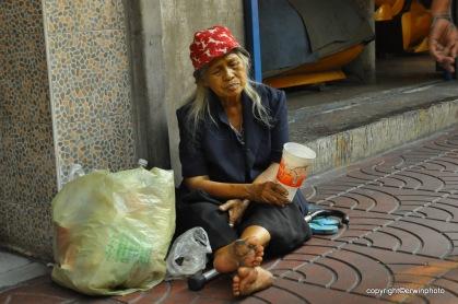 Bettlerin in Bankok
